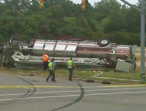 A Raleigh fire truck overturned in downtown, prompting authorities to close parts of two roads.