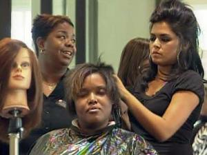 Students at The Emerald Academy, located at 8551 Glenwood Ave., Suite 100, in Raleigh, work on a client's hair. The academy offers services at a reduced rate.