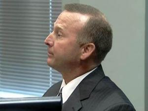 Former Highway Patrol trooper Ron Ezzell testifies during a July 13, 2009, hearing during which he appealed his firing by the agency.
