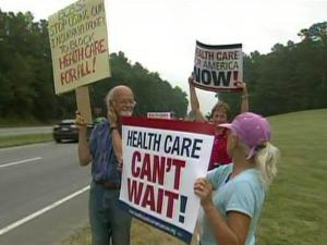 State employees rally outside the headquarters of Blue Cross Blue Shield of North Carolina on July 15, 2009, calling for the insurer to support health care reform.