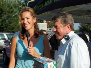 MIX 101.5 host Lynda Loveland and WRAL Anchor David Crabtree smile as they ask viewers to come support the BackPack Buddies food drive on Aug. 20, 2009.
