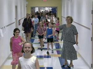 Students rush into Lacy Elementary, 2001 Lake Boone Trail in Raleigh, on Aug. 24, 2009. The school had just reopened after renovations.
