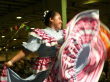 Ellie Beralta, of Snow Camp, performs a traditional Mexican dance with Ballet Folklorico 'Epiritu Latino.'