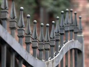 A Fayetteville Observer newspaper carrier was impaled on this wrought-iron fence in an Old Street alley on Aug. 31, 2009.