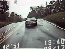 A screenshot of dash camera video from a car chase involving two Chatham County deputies and a suspect on Sept. 17, 2009.