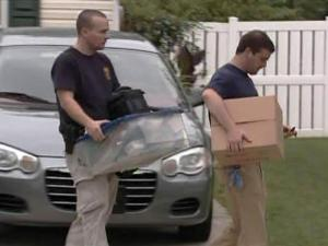Federal agents remove items from a Holly Springs house where Anes Subasic, one of eight man charged in an international terrorism plot, lived with his father. Agents searched the house for about nine hours on Sept. 25, 2009.