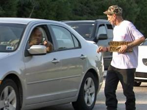 Martin Sansalone asks drivers for money Monday afternoon, Sept. 28, 2009, along Interstate 440 and Poole Road.