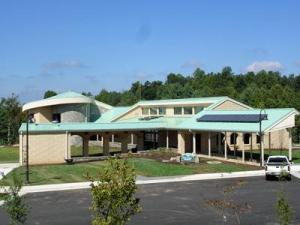 Three solar panels above the main entrance of the Northwest North Carolina Visitor Center/Rest Area capture the sun's energy and use it to preheat the hot water in the restroom faucets.