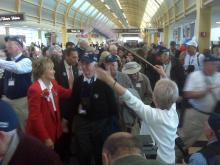 Former U.S. Sen. Elizabeth Dole led a group in a visit to the World War II memorial.