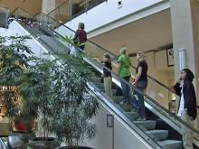 Worker catches girl falling from mall escalator