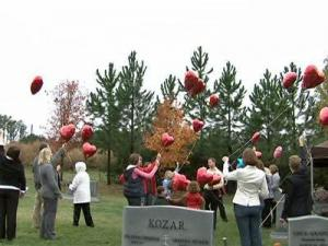 Family and friends release balloons Sunday, Nov. 1, 2009, in remembrance of Michelle Young at Cary's Wake Memorial Park.
