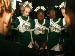 The Pine Forest High School JV cheerleading team prays before their performance at the 2009 NCHSAA Invitational Cheerleading Championship in Raleigh on Saturday, Nov. 7. (photo by Will Okun)