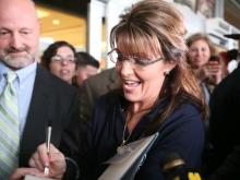 People braved a cold, drizzly Monday for a chance to meet former Republican vice presidential candidate Sarah Palin, who was signing copies of her memoir at the North Post-Exchange in Fort Bragg.