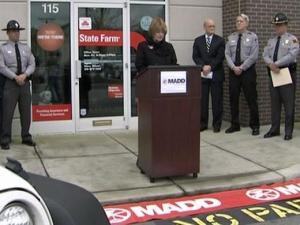 Mothers Against Drunk Driving launched their Tie One on for Safety holiday ribbon campaign at the State Farm Insurance Office in Raleigh on Tuesday.
