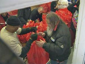 Volunteers at the Opportunities Industrialization Center in Wilson handed out 25-pound bags of food, including meat, vegetables and other staples, to about 2,000 people on Wednesday, Nov. 25, 2009.