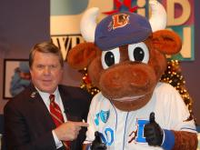 WRAL's David Crabtree and the Durham Bulls mascot, Wool E. Bulll, helped out during the WRAL Coats for Children telethon on Friday, Dec. 11, 2009.