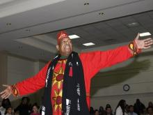 Chuck Davis encourages the crowd to help dance in the New Year.
