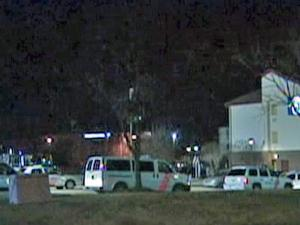 Authorities investigate a shooting Sunday, Jan. 3, 2010, at the Motel 6 at 1370 N Wesleyan Blvd. in Rocky Mount.