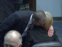 Vann Sauls hugs Portia Snead in court on Jan. 25, 2010. Both pleaded guilty to taking part in a Johnston County ticket-fixing scheme.
