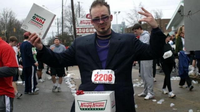 Paul Smith, of Raleigh, emulates Justin Timberlake at the 2010 Krispy Kreme Challenge in Raleigh on Saturday, Feb. 6.