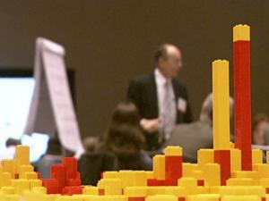 Local leader used children's toys to build models for the future of the Triangle at the Reality Check conference in February 2009