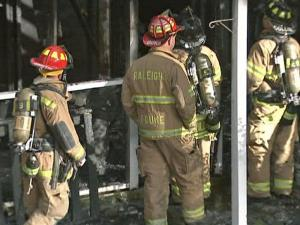 Firefighters brought a blaze at a Raleigh apartment building under control in about an hour Friday.