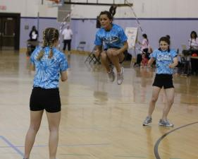 Cary SuperSkippers Amy Tarquini gets serious hang time while Jessie and Melissa Robinson turn a complicated double-dutch sequence during the AAU Jump Rope Qualifier competition at UNC's Fetzer Gym, Saturday, March 6, 2010. The event was hosted by Chapel Hill's Skipsations. (Photo by Todd Melet)