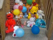 People have put together a makeshift memorial at the Redwood Village Apartments in Selma where a mother and child died in a fire on Wednesday, March 10, 2010.
