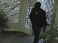 Surveillance photos from a Garner Bank of America that show a man, identified by authorities as Samuel James Cooper, robbing the bank.