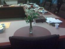 A single rose sits in front of Kathy Taft's empty chair at a North Carolina State Board of Education meeting on April 1, 2010 - the first since Taft's March 9, 2010, death from injuries she suffered during an attack three days earlier.