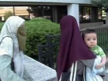 Terror suspect sees infant son in court