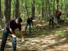 Employees of the Cary office of CA, Inc. volunteered at William B. Umstead State Park, where they assisted with litter clean-up around the lake and helped prepare fire buffers. (Submitted by Emily Rosen)