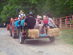 Visitors enjoy hayride at the Chapel Hill Creamery during the Piedmont Farm Tour on Saturday, April 24, 2010.