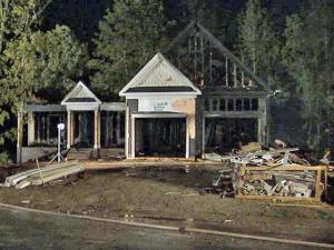 Early morning fires hit two adjacent houses under construction on Skygrove Drive in the Glen Laurel subdivision in Clayton on May 2, 2010. Police believe they were the sixth and seventh buildings under construction to be destroyed by arson since Halloween 2009.