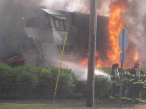 Viewer-submitted photo of an Amtrak passenger train that caught fire after hitting a tractor-trailer stuck on tracks in Mebane on Thursday, May 12, 2010.