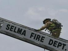Firefighters battle Selma church fire