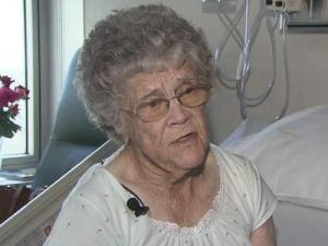 Dorothy Holland says she was working barefoot in her back yard when a rabid fox attacked her. A neighbor, who heard her screaming for help, scared the fox away and eventually killed it.