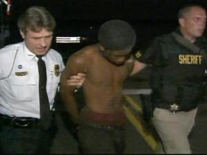 Authorities arrest one of the suspects in a robbery at the Exxon Short Stop Food Mart.