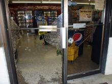The front door of the Exxon Short Stop Food Mart in Lakeview was shattered during a June 29, 2010, shootout that followed a robbery. (Photo courtesy of Frank Staples)