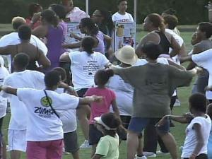 People take part in Dancing in the Park at Chavis Park in Raleigh on Monday, July 19, 2010.