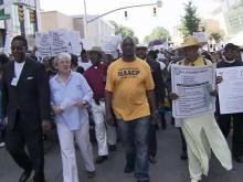 About 1,000 people took to downtown Raleigh's streets Tuesday morning, July 20, 2010, to protest the way students will be assigned to Wake County schools under a controversial policy opponents fear will resegregate schools.