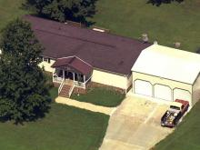 Durham police search Mebane home in hidden remains case