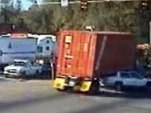 A red-light camera on U.S. 64 in Knightdale captured this image of a tractor-trailer running a stop light and slamming into a car.