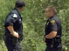 Police were on the scene where human remains were found beneath a railroad bridge across the Cape Fear River on Aug. 25, 2010.