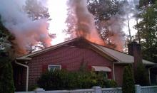 Fire hit a vacant house at 609 Vermont St. in Smithfield early Sept. 25, 2010. (Photo courtesy of Josh Langdon)