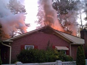 A fire hit a vacant house at 609 Vermont St. early Saturday, Sept. 25, 2010. (Photo courtesy of Josh Langdon)