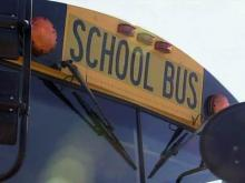 School bus driver thwarts men's attempts to board