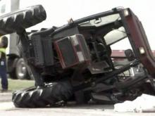 A mowing tractor lies on northbound I-95 in Cumberland County after being hit by a tractor-trailer on Oct. 27, 2010. The mower operator was killed.