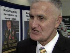"Retired Army Gen. Hugh Shelton signed copies of his memoir, ""Without Hesitation,"" at Fort Bragg on Nov. 29, 2010."