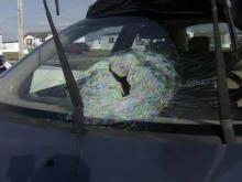 Woman hurt when brick thrown at car on highway